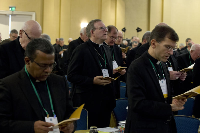 Auxiliary Bishop Robert Barron of Los Angeles, center, along with other bishops, participates in a morning prayer, during the United States Conference of Catholic Bishops (USCCB), 2019 Spring meetings in Baltimore, Tuesday, Jun 11, 2019. (AP Photo/Jose Luis Magana)