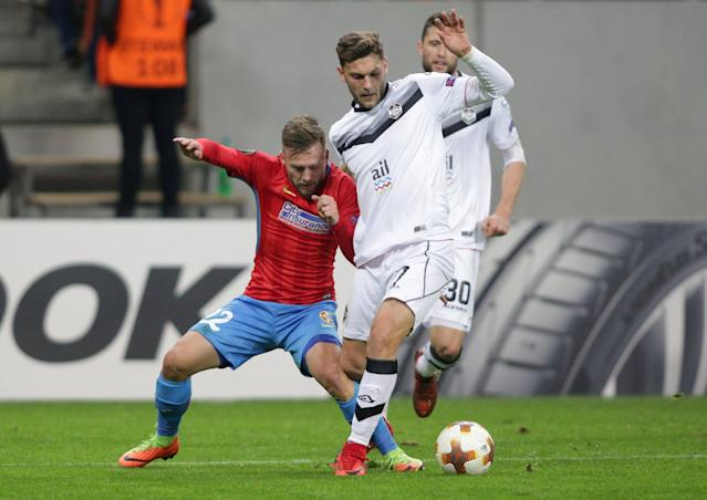 Soccer Football - Europa League - Steaua Bucharest vs FC Lugano - National Arena, Bucharest, Romania - December 7, 2017 Lugano's Balint Vecsei in action with Steaua Bucharest's Catalin Golofca REUTERS/Octav Ganea ROMANIA OUT. NO COMMERCIAL OR EDITORIAL SALES IN ROMANIA
