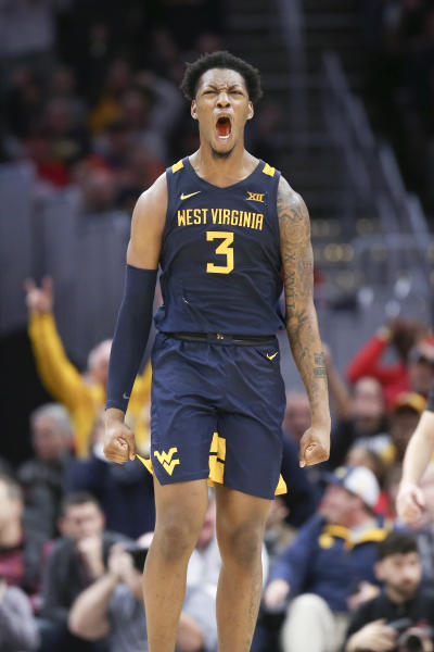 West Virginia's Gabe Osabuohien celebrates during the second half of an NCAA college basketball game against Ohio State Sunday, Dec. 29, 2019, in Cleveland. West Virginia defeated Ohio State 67-59. (AP Photo/Ron Schwane)