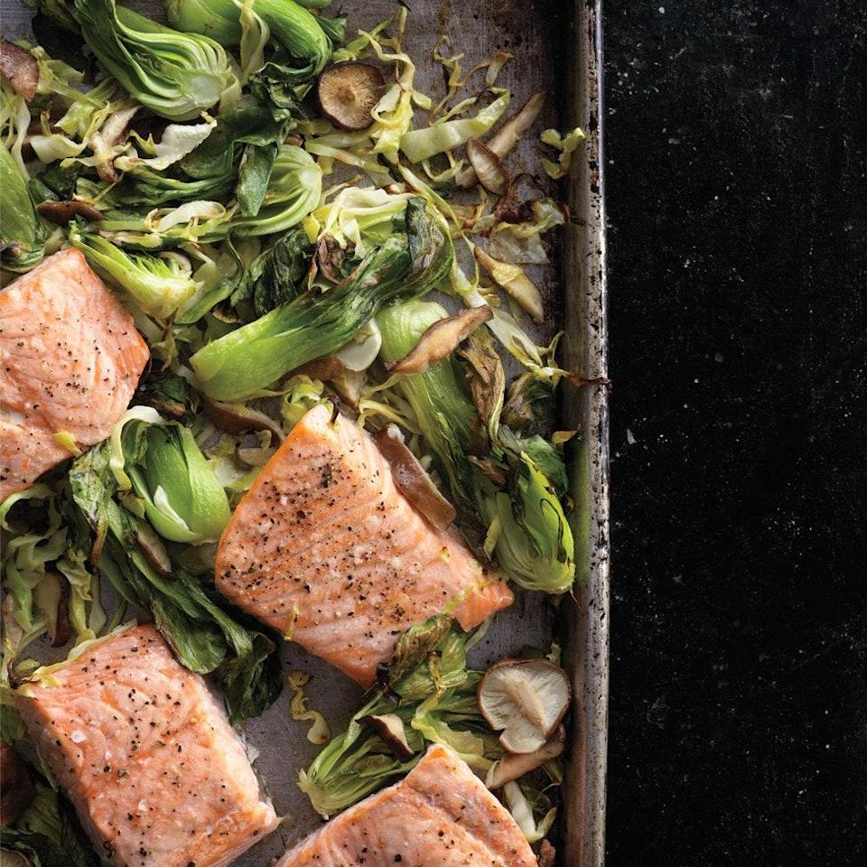 """In this sheet-pan dinner, bok choy, cabbage and shiitakes are roasted on one side, while tender flaky <a href=""""https://www.epicurious.com/ingredients/14-ways-to-eat-salmon-for-dinner-tonight-gallery?mbid=synd_yahoo_rss"""" rel=""""nofollow noopener"""" target=""""_blank"""" data-ylk=""""slk:salmon"""" class=""""link rapid-noclick-resp"""">salmon</a> cooks opposite. A pre-heat helps with browning; wasabi brings nasal-clearing heat to the finishing sauce. <a href=""""https://www.epicurious.com/recipes/food/views/wasabi-salmon-with-bok-choy-green-cabbage-and-shiitakes-394719?mbid=synd_yahoo_rss"""" rel=""""nofollow noopener"""" target=""""_blank"""" data-ylk=""""slk:See recipe."""" class=""""link rapid-noclick-resp"""">See recipe.</a>"""
