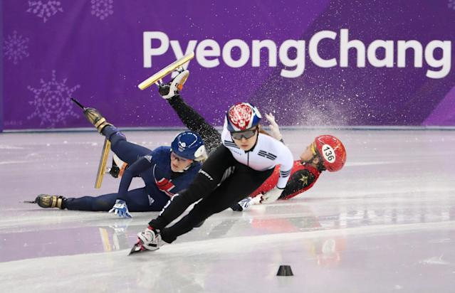 Short Track Speed Skating Events - Pyeongchang 2018 Winter Olympics - Women's 1500m Semifinal - Gangneung Ice Arena - Gangneung, South Korea - February 17, 2018 - Choi Min-jeong of South Korea leads as Elise Christie of Britain and Li Jinyu of China crash. REUTERS/Lucy Nicholson TPX IMAGES OF THE DAY