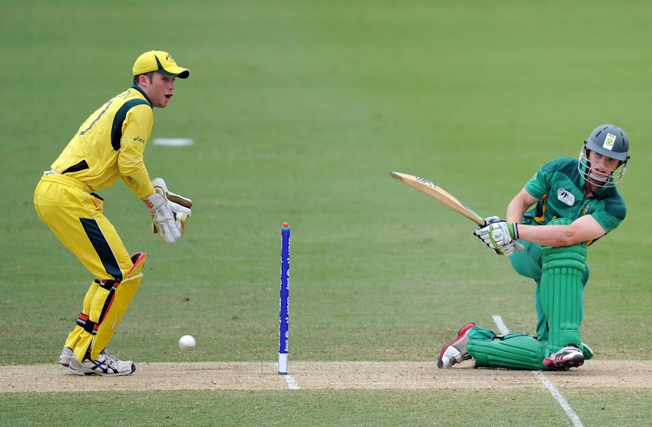 TOWNSVILLE, AUSTRALIA - AUGUST 21:  Murray Coetzee of South Africa plays a sweep shot during the ICC U19 Cricket World Cup 2012 Semi Final match between Australia and South Africa at Tony Ireland Stadium on August 21, 2012 in Townsville, Australia.  (Photo by Malcolm Fairclough-ICC/Getty Images)