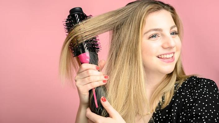 Trust us, the Revlon One-Step Hair Dryer and Volumizer will change mom's hair game.