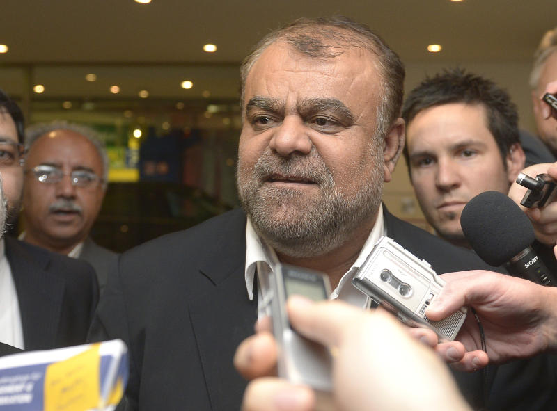 Iran's Minister of Petroleum Rostam Ghasemi talks to journalists as he arrives at a hotel for the Organization of the Petroleum Exporting Countries, OPEC, conference in Vienna, Austria, Thursday, May 30, 2012. Once the symbol of oil dominance, OPEC faces new challenges as its members gather for a ministerial meeting on how much crude to pump. For the 12 oil ministers from countries ranging from Venezuela to Nigeria and Iran, the formal focus of Friday's get-together is to determine production levels. (AP Photo/Hans Punz)