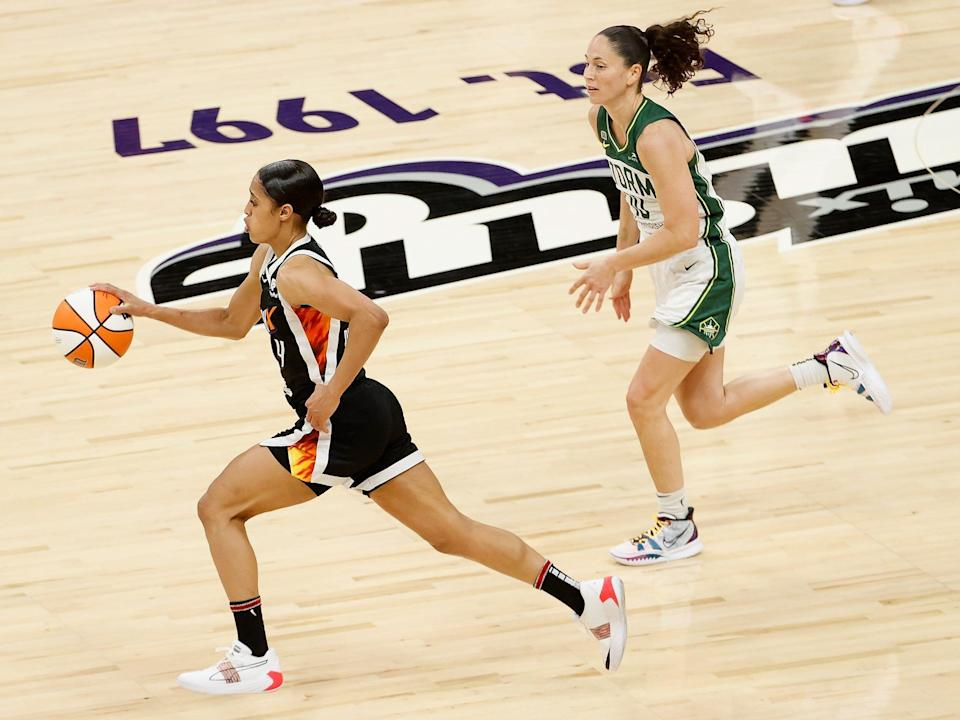 Mercury point guard Skylar Diggins-Smith dribbles past Sue Bird of the Seattle Storm.