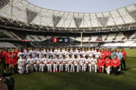 The Boston Red Sox pose for a team pictures in London, Friday, June 28, 2019. Major League Baseball will make its European debut with the New York Yankees versus Boston Red Sox game at London Stadium this weekend. (AP Photo/Tim Ireland)