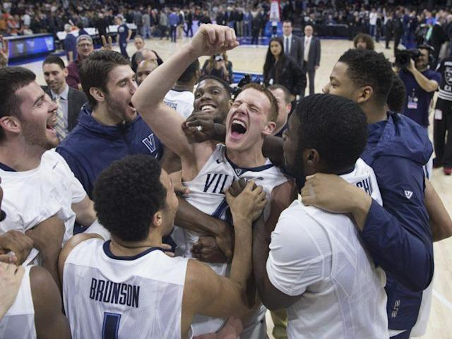 "<a class=""link rapid-noclick-resp"" href=""/ncaab/players/131427/"" data-ylk=""slk:Donte DiVincenzo"">Donte DiVincenzo</a> (center) ghosted in from the left to the front of the rim to beat Virginia with a buzzer-beating tip-in. (Getty)"