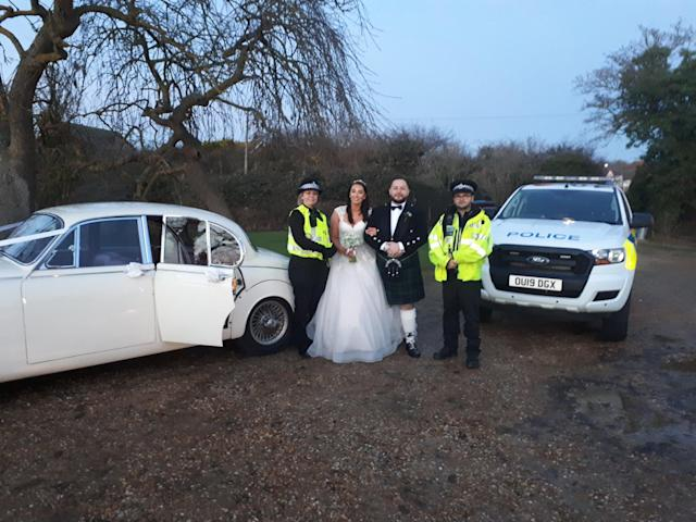Jenna Bassam and her new husband Craig were pleased when the police showed up to their wedding (Bedfordshire Police)