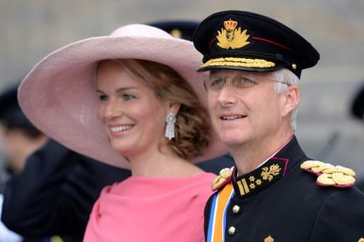 Prince Philippe of Belgium and his wife Princess Mathilde leave the Nieuwe Kerk (New Church) in Amsterdam on April 30, 2013 after attending the investiture of King Willem-Alexander of the Netherlands.    AFP PHOTO / PATRIK STOLLARZ