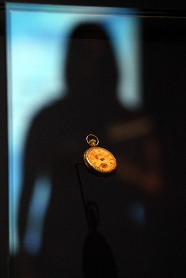 A visitor to the SeaCity Museum looks at a pocket watch that belonged to Titanic steward Sidney Sedunary that is displayed at the museum's Titanic exhibition on April 3, 2012 in Southampton, England. The new SeaCity Museum, which will open at 1.30pm on April 10, 100 years to the day since the Titanic set sail from the city. The museum, which cost 15 GBP million, promises to tell the largely untold story of Southampton's Titanic crew and the impact the tragedy had on the city, as well as featuring other aspects of the city's seafaring past. (Photo by Matt Cardy/Getty Images)