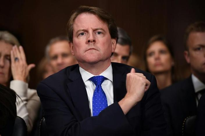 A federal judge ruled that former White House Counsel Don McGahn cannot claim absolute immunity from testifying in impeachment hearings (AFP Photo/SAUL LOEB)