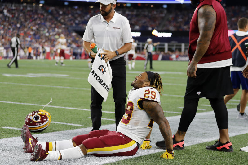 FOXBOROUGH, MA - AUGUST 09: Washington Redskins running back Derrius Guice (29) winces in pain during a preseason NFL game between the New England Patriots and the Washington Redskins on August 9, 2018, at Gillette Stadium in Foxborough, Massachusetts. The Patriots defeated the Redskins 26-17. (Photo by Fred Kfoury III/Icon Sportswire via Getty Images)