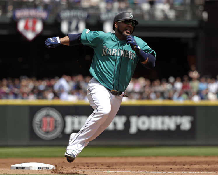 Seattle Mariners' Edwin Encarnacion rounds third on his way to score against the Houston Astros in the first inning of a baseball game Thursday, June 6, 2019, in Seattle. (AP Photo/Elaine Thompson)