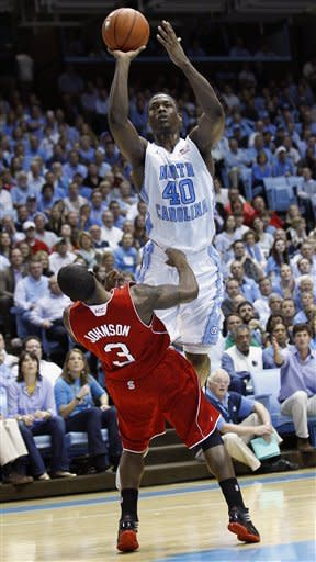 North Carolina's Harrison Barnes (40) shoots over North Carolina State's Alex Johnson (3) during the first half of an NCAA college basketball game in Chapel Hill, N.C., Thursday, Jan. 26, 2012. (AP Photo/Gerry Broome)
