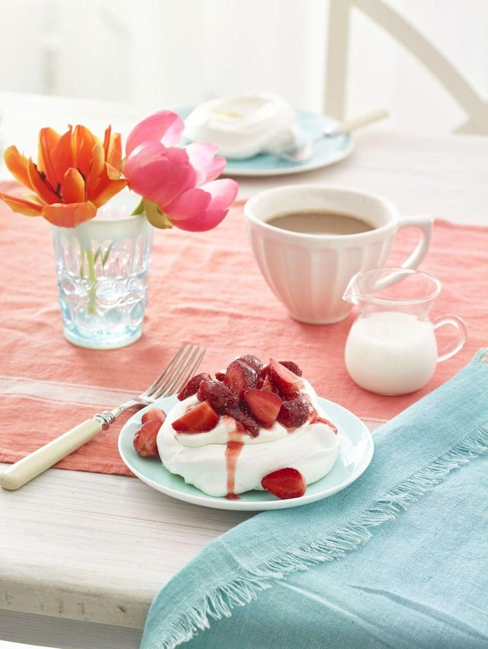 """<p>These light and airy single-serve treats are an elegant (gluten-free!) way to end a special meal.</p><p><em><a href=""""https://www.womansday.com/food-recipes/food-drinks/recipes/a54431/pavlovas-with-strawberries-and-cream-recipe/"""" rel=""""nofollow noopener"""" target=""""_blank"""" data-ylk=""""slk:Get the recipe from Woman's Day »"""" class=""""link rapid-noclick-resp"""">Get the recipe from Woman's Day »</a></em></p>"""