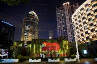 Workers build an installation ahead of the 100th anniversary of the Communist Party of China, in Shanghai