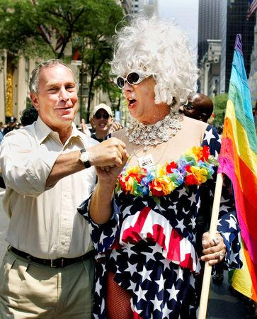 FILE PHOTO: New York Mayor Michael Bloomberg greets Gilbert Baker as they take part in the annual Gay Pride parade in New York City
