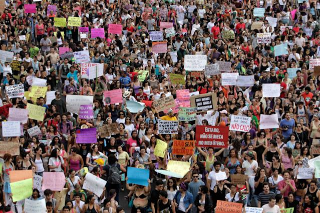 Demonstrators protest against sexism and in defense of womens' rights in Brasilia, Brazil, Saturday, June 22, 2013. Demonstrators once again took to the streets of Brazil on Saturday, continuing a wave of protests that have shaken the nation and pushed the government to promise a crackdown on corruption and greater spending on social services. (AP Photo/Eraldo Peres)