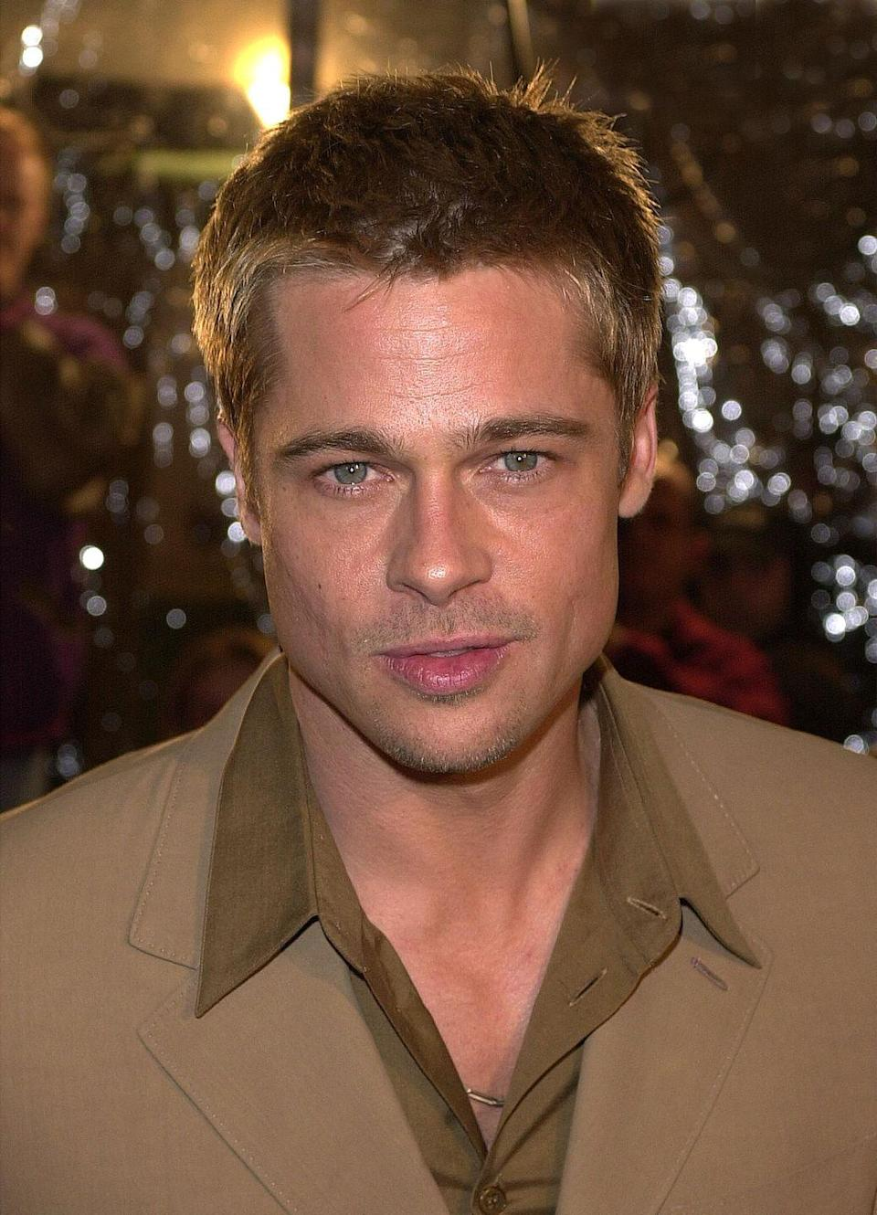 <p>Brad Pitt kept it pretty consistent in the early 2000s with this movie star cut featuring short, spiky blonde hair. </p>