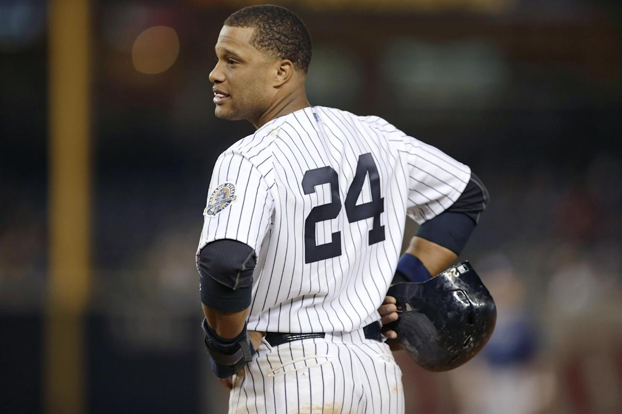 New York Yankees' Robinson Cano looks toward the dugout during the eighth inning of the Yankees' 8-3 loss to the Tampa Bay Rays in a baseball game Wednesday, Sept. 25, 2013, in New York. The Cleveland Indians' win over the Chicago White Sox on Wednesday night knocked the Yankees out of the playoff race. (AP Photo/Kathy Willens)