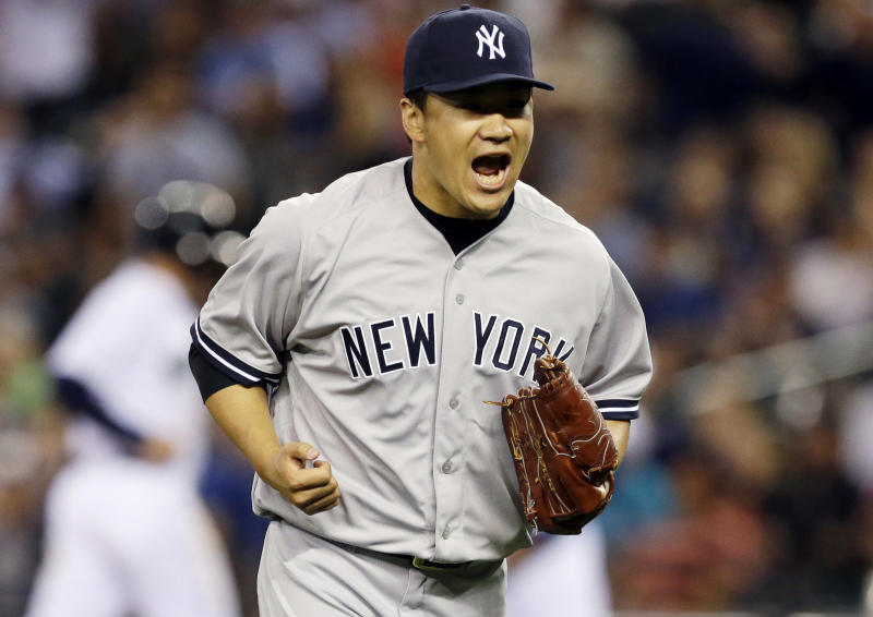 New York Yankees starting pitcher Masahiro Tanaka yells after the eighth inning of a baseball game against the Seattle Mariners ended with a double play, Wednesday, June 11, 2014, in Seattle. Tanaka had a shutout going until the Mariners' Robinson Cano hit a two-run home run in the ninth inning, but Tanaka finished the complete game and the Yankees beat the Mariners 4-2. (AP Photo/Ted S. Warren)