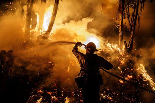 PHOTO: Firefighters sprays water on a back fire while battling the spread of the Maria Fire as it moves quickly towards Santa Paula, Calif., on Nov. 1, 2019. (Marcus Yam/Los Angeles Times/Polaris)