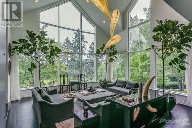 "<p>This compound on Lake Simcoe offers stunning panoramic views, massive windows, a swimming pool, a gazebo, a glass-enclosed boat house and 525 feet of private waterfront. (<a href=""https://www.point2homes.com/CA/Home-For-Sale/ON/Oro-Medonte/2615-RIDGE-Road-West/37432151.html"" rel=""nofollow noopener"" target=""_blank"" data-ylk=""slk:Point2Homes"" class=""link rapid-noclick-resp"">Point2Homes</a>) </p>"