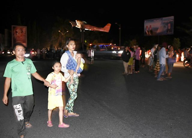 <p>People react on the street following an earthquake near the former Selaparang Airport, Mataram, Lombok, Indonesia, Aug. 5, 2018. (Photo: Antara Foto/Ahmad Subaidi/ via Reuters) </p>