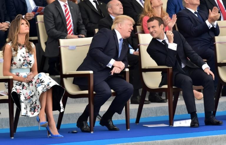 US President Donald Trump (2nd L) decided he wanted a large military parade in Washington after taking in the Bastille Day parade in Paris with French President Emmanuel Macron (2nd R) in 2017