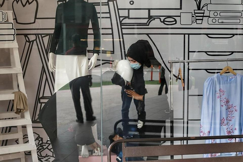 Sales reps dress mannequins at Jakel Mall in Kuala Lumpur May 4, 2020. LPF claimed that the displaying of undergarments is allegedly indecent and offensive. — Picture by Ahmad Zamzahuri