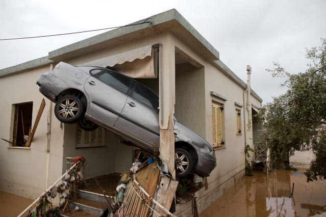 <p>A car at the entrance of a flooded house after the water has receded in the town of Mandra western Athens, on Thursday, Nov. 16, 2017. (Photo: Petros Giannakouris/AP) </p>