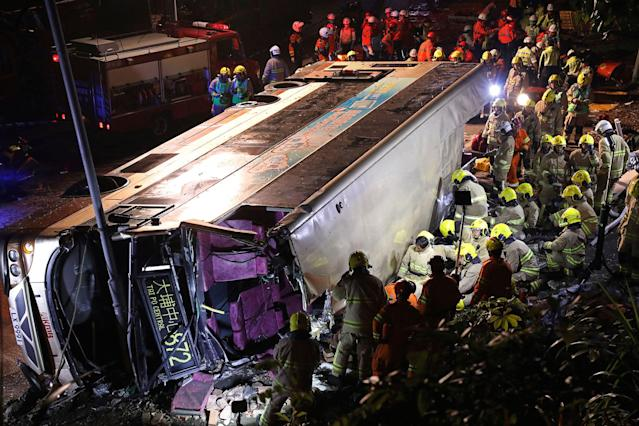 <p>Firemen hurry to try to remove injured passengers from a double-decker lying on its side in Hong Kong, Saturday, Feb. 10, 2018. (Photo: Apple Daily via AP) </p>