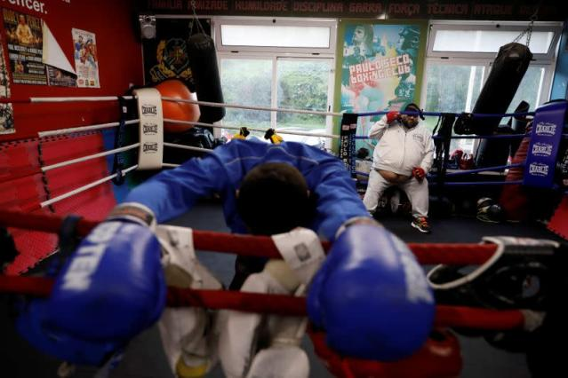 Boxer Farid Walizadeh rests during a training session in Lisbon