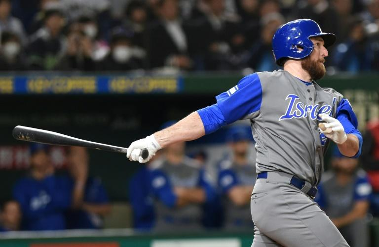 Israeli designated hitter Ike Davis hits an RBI single in the top of the ninth inning during the World Baseball Classic Pool E second round match in Tokyo March 15, 2017