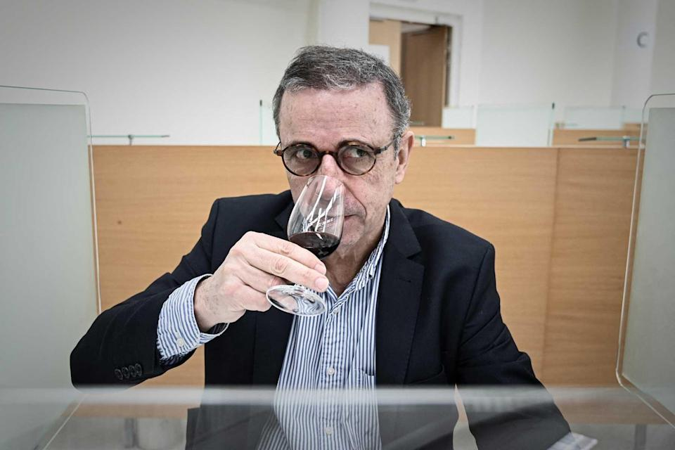 """Mayor of Bordeaux Pierre Hurmic tastes wine from """"anonymised"""" bottles of Petrus including one that went in space, at the University of Bordeaux Institut des Sciences de la Vigne et du Vin (ISVV - Institute of Vine & Wine Science) in Villenave-d'Ornon, on the outskirts of Bordeaux, southwestern France, on March 1, 2021."""