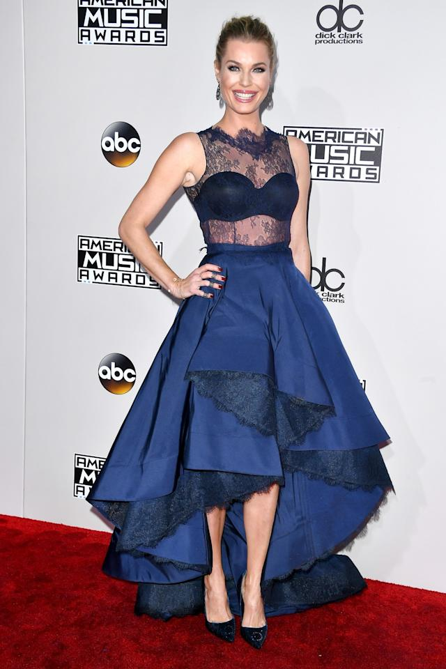 <p>The <em>Librarian</em> actress paired a layered ball skirt with a sheer lace top. <em>(Photo: Getty Images)</em> </p>