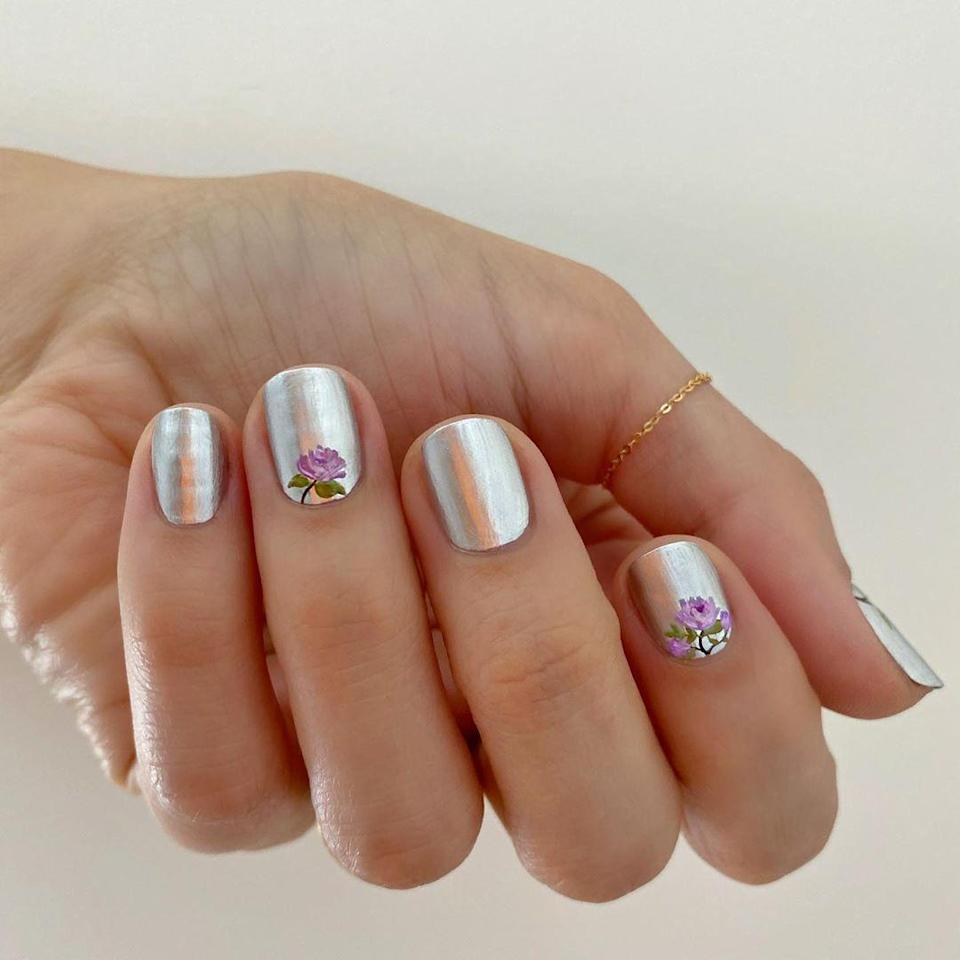 "I wouldn't think of pairing sleek silver with a floral decal, but somehow it totally works. Try Sally Hansen Insta Dri in <a href=""https://shop-links.co/1716910261352889949"" rel=""nofollow noopener"" target=""_blank"" data-ylk=""slk:Silver Stallion"" class=""link rapid-noclick-resp"">Silver Stallion</a> for your base, and these <a href=""https://www.etsy.com/listing/814271640/flower-nail-decals-floral-nail-decals?ga_order=most_relevant&ga_search_type=all&ga_view_type=gallery&ga_search_query=rose+nail+decals&ref=sr_gallery-2-30&organic_search_click=1"" rel=""nofollow noopener"" target=""_blank"" data-ylk=""slk:nail stickers"" class=""link rapid-noclick-resp"">nail stickers</a> for your accent."