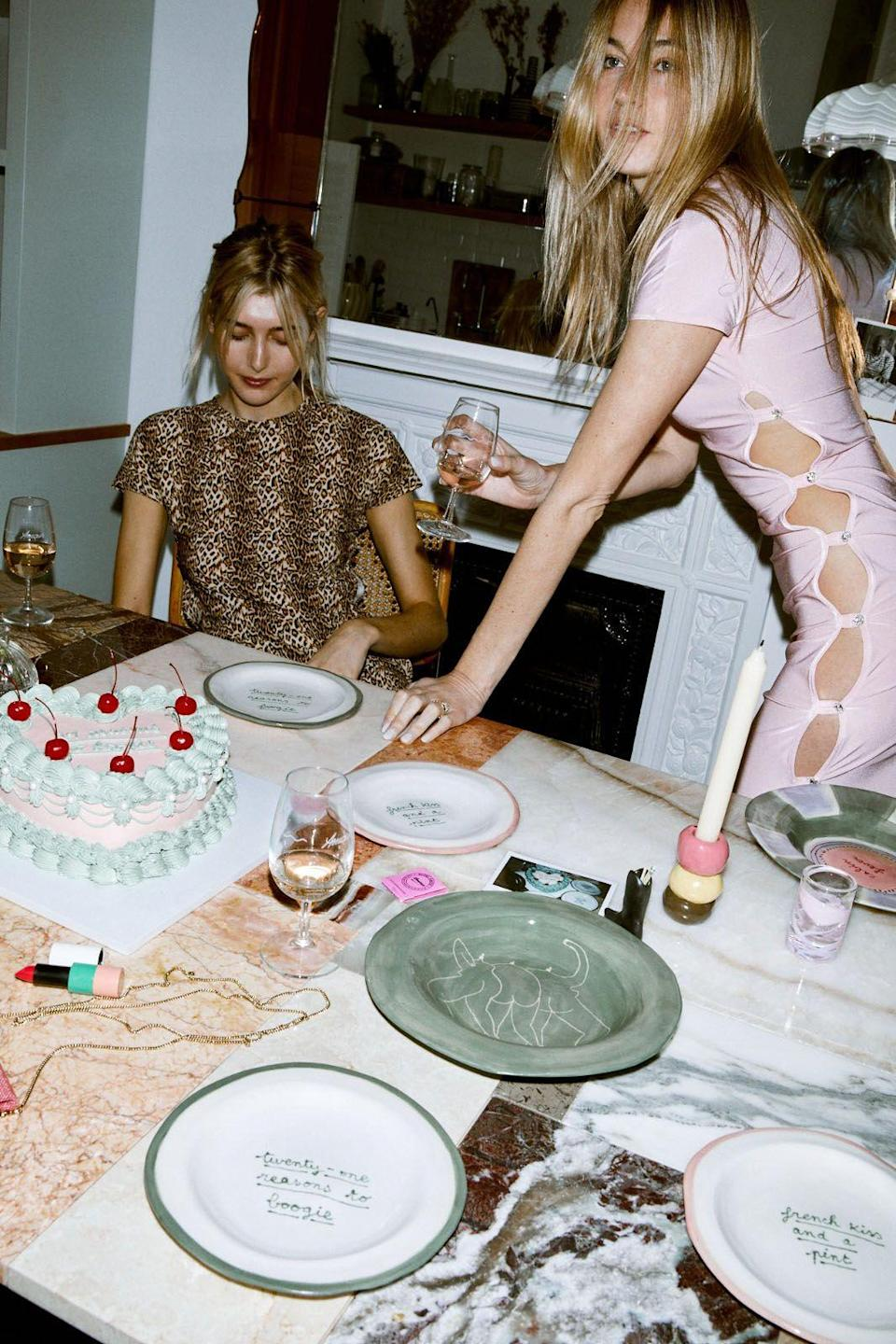"""<p>Lockdown is mercifully over and the option to socialise inside with friends and family now a reality once again. To help you achieve a flawless and chic evening, Parisian writer and broadcaster Camille Charrière has imparted her ultimate tips on how to throw the perfect dinner party. In fact, she's so committed to raising the hosting bar, that she's designed <a href=""""https://www.theyellowworld.co.uk/shop"""" rel=""""nofollow noopener"""" target=""""_blank"""" data-ylk=""""slk:a limited edition plate collection with ceramic artist Laetitia Rouget"""" class=""""link rapid-noclick-resp"""">a limited edition plate collection with ceramic artist Laetitia Rouget</a> which celebrate the end of lockdown as we enter the new roaring twenties. </p><p>We know that perennial ingredients of good food, drink, friends, good conversation are key to a successful night in, but what else can you do to ensure that your guests have an excellent, fun-filled time? Allow Charrière to offer her insights.<br></p>"""