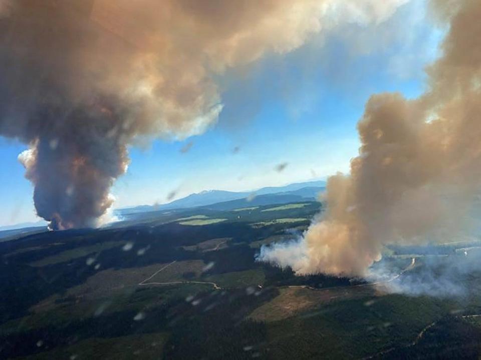 Plumes of smoke from the Long Loch wildfire (K51040) and the Derrickson Lake wildfire (K51041), British Columbia on Wednesday (BC Wildfire Service/AFP via Gett)