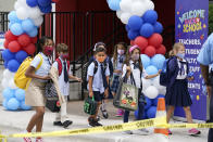 Students walk out of iPrep Academy on the first day of school, Monday, Aug. 23, 2021, in Miami. Schools in Miami-Dade County opened Monday with a strict mask mandate to guard against coronavirus infections. (AP Photo/Lynne Sladky)