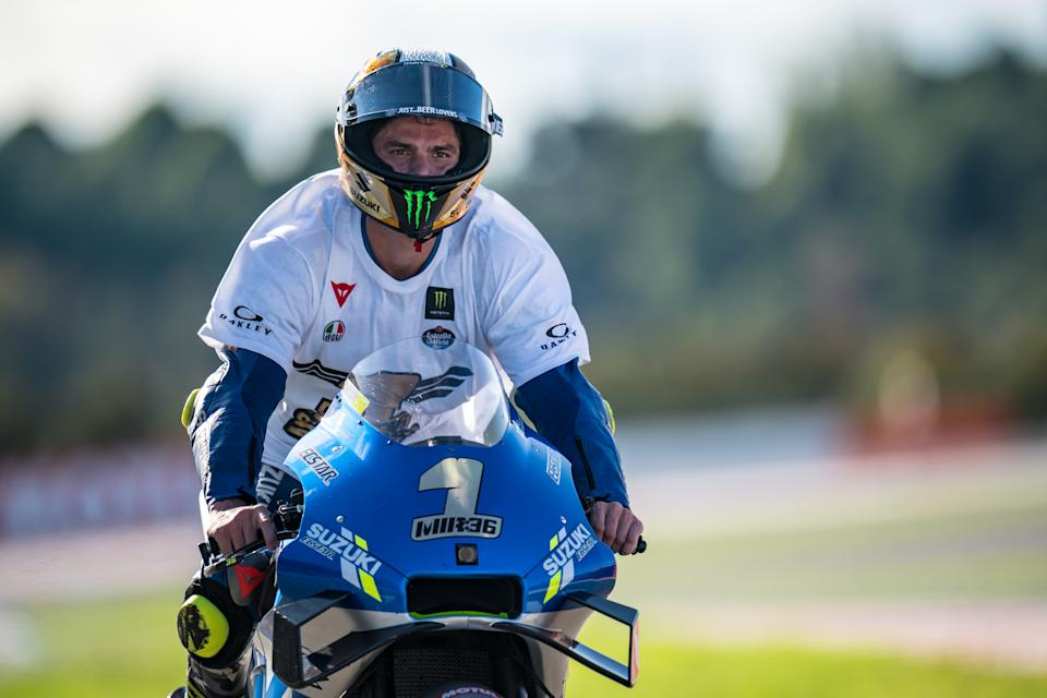 VALENCIA, SPAIN - NOVEMBER 15: MotoGP 2020 world champion MJoan Mir of Spain and Team SUZUKI ECSTAR rolls into the pitlane with his special helmet and shirt during the MotoGP of Comunitat Valenciana at Comunitat Valenciana Ricardo Tormo Circuit on November 15, 2020 in Valencia, Spain. (Photo by Steve Wobser/Getty Images)