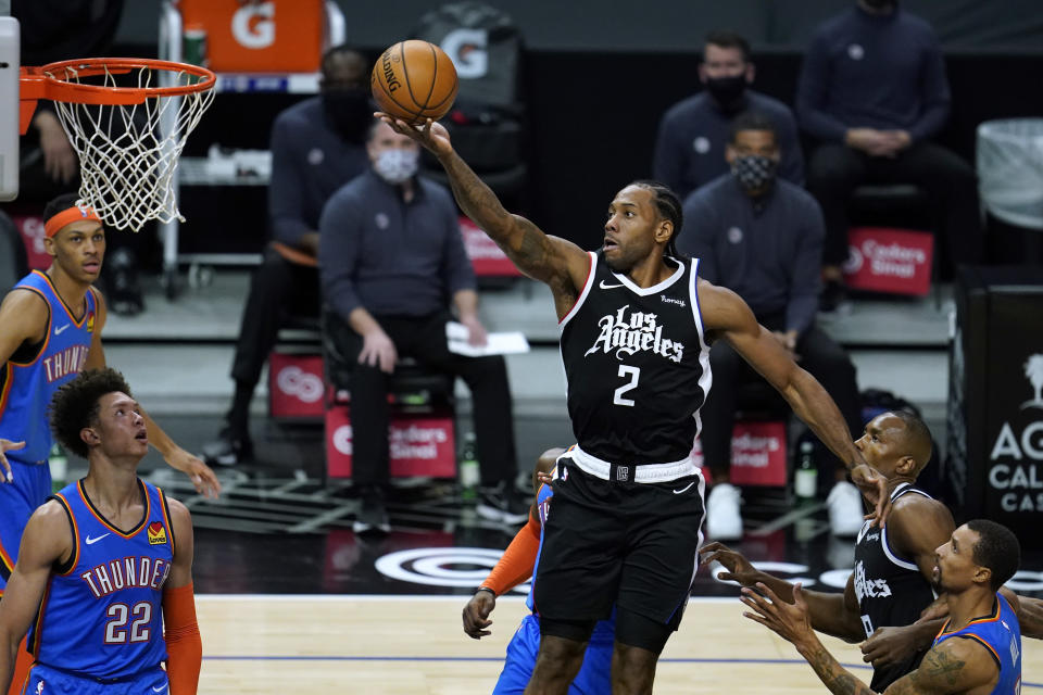 Los Angeles Clippers forward Kawhi Leonard (2) shoots during the first quarter of the team's NBA basketball game against the Oklahoma City Thunder on Friday, Jan. 22, 2021, in Los Angeles. (AP Photo/Ashley Landis)