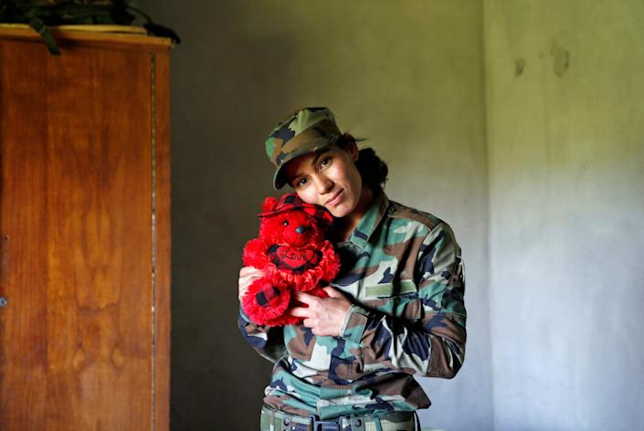 Dahir poses with a teddy bear. Many of the women had left their children and families to join this fight.