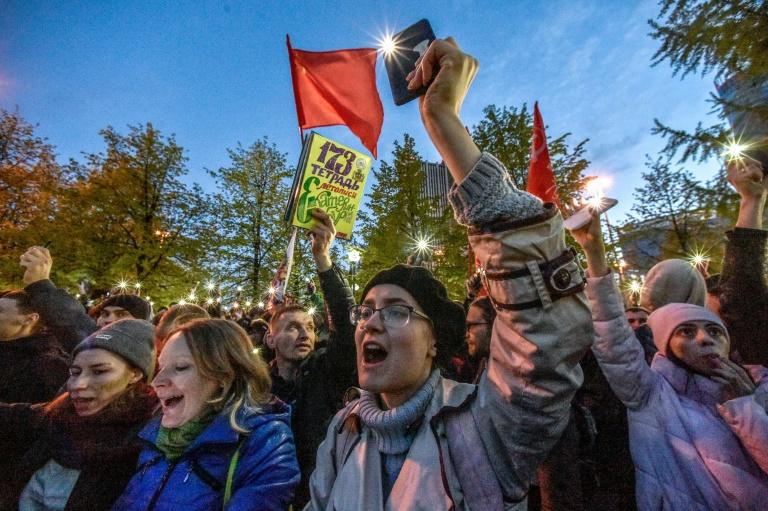 Activists protesting against a plan to build an Orthodox cathedral rally at a construction site in a park in the Russian Urals city of Yekaterinburg on May 15, 2019