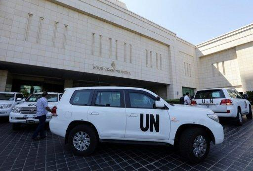 The UN chemical weapons investigation team arrives in Damascus on August 18, 2013. UN inspectors tasked with investigating whether chemical weapons have been used in the Syrian conflict arrived in Damascus on Sunday, an AFP journalist reported