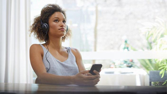 Stock image of a woman listening to music