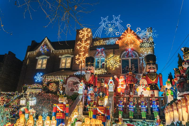 New York, United States, December 25, 2108: A beautiful house with big figures and lots of Christmas decorations on Dyker Heights Street at night - Bottom view