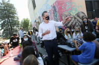Gov. Gavin Newsom meets with students at Melrose Leadership Academy, a TK-8 school in Oakland, Calif., on Wednesday, Sept. 15, 2021, one day after defeating a Republican-led recall effort. The recall election that once threatened Newsom's political career has instead given it new life. (AP Photo/Nick Otto)