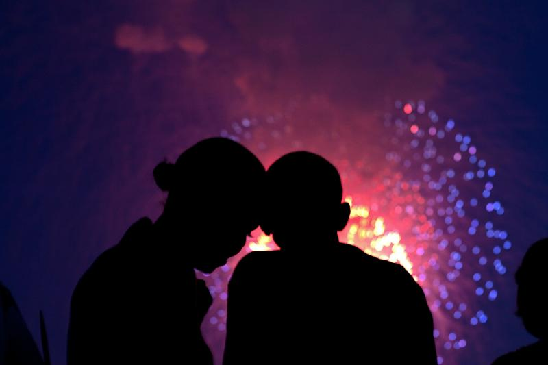 President Barack Obama and first lady Michelle Obama watch the fireworks over the National Mall from the roof of the White House on July 4, 2010.