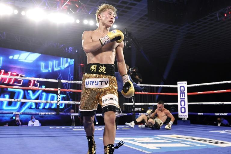 Japanese boxer Naoya Inoue walks to the corner after knocking down Australian challenger Jason Moloney during their bantamweight title bout at MGM hotel and casino in Las Vegas